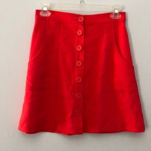 A line button front mini skirt with pockets
